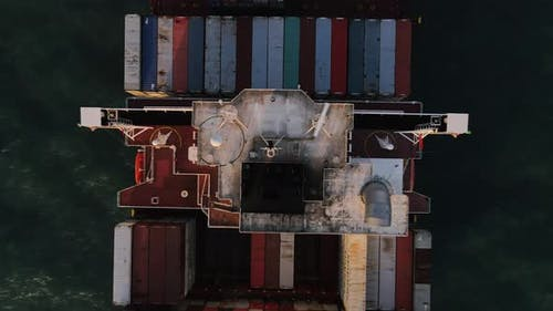 Container ship carrying container for import and export, business logistic and transportation.