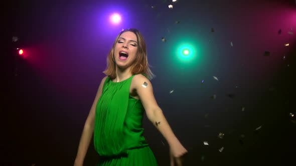 Thumbnail for Dancing of Woman in Green Dress. Close-up. Slow Motion