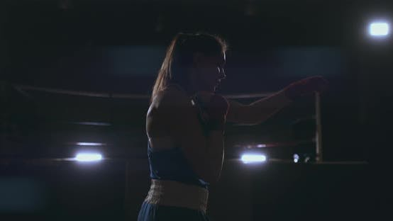Thumbnail for Professional Female Boxer Blows Conducting a Fight with a Shadow in a Dark