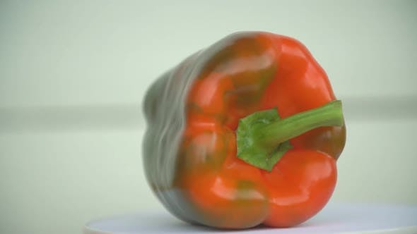 Cover Image for Green-orange Pepper on the Table