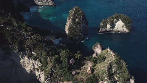 Thumbnail for Aerial Fly Over View Of Multiple Tree House Hostels on Cliff