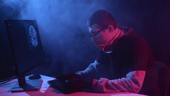 Thumbnail for Spy Enters Virus Data Into the Computer. Black Smoke Background
