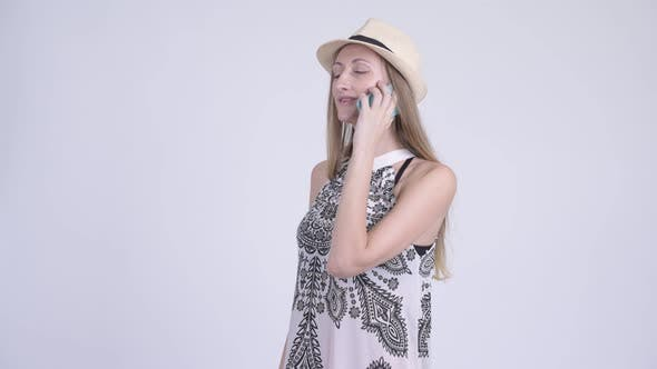 Thumbnail for Portrait of Happy Blonde Tourist Woman Talking on the Phone