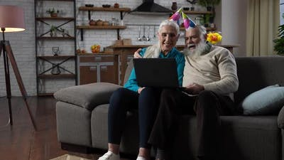 Happy Elders Congratulating Child with Birthday
