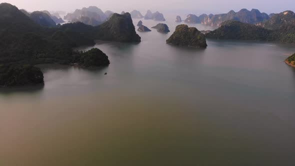Thumbnail for Aerial: unique flying over Ha Long Bay and Cat Ba island at sunset Vietnam