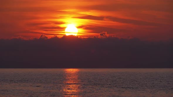 Thumbnail for Sunset in the Clouds Over the Sea. Orange Path Sunset in the Sea