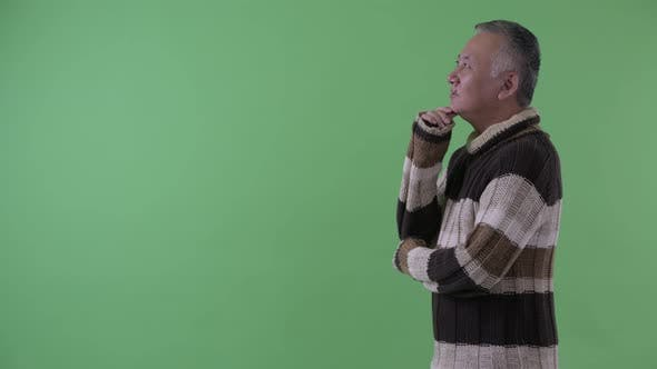 Thumbnail for Profile View of Happy Mature Japanese Man Thinking Ready for Winter