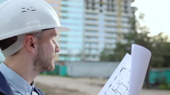 Thumbnail for Construction engineer looking at building blueprints