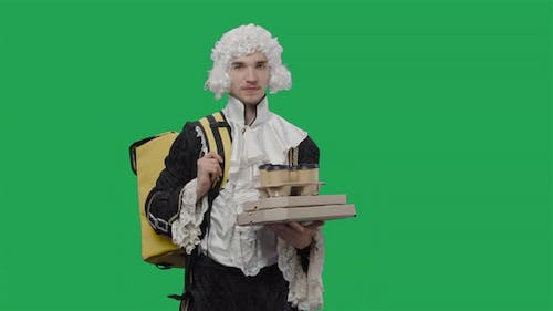 Portrait of Courtier Gentleman in Black Historical Vintage Suit and White Wig Delivering Food and
