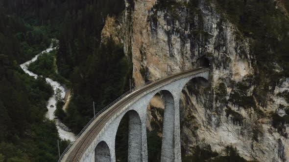 Aerial Close-up Shot of Famous Landwasser Viaduct Bridge Tunnel Entrance, Epic Travel Destination