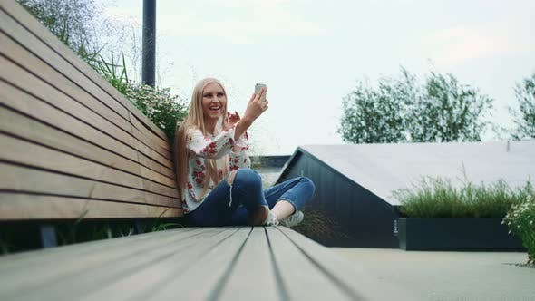 Thumbnail for Young Lady Making Video Call on Green Roof