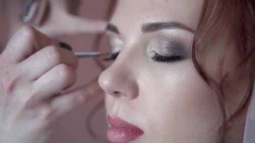 Make-up Artist Paints the Eyes of the Bride in the Morning Before the Wedding, Close-up, Slow Motion