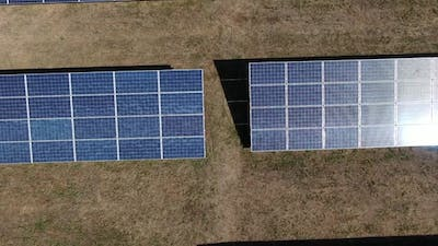 Top View of the Rows of Solar Panels in the Field Solar Power Station