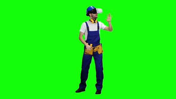 Thumbnail for Engineer with Virtual Reality Glasses Looks at the Building. Green Screen
