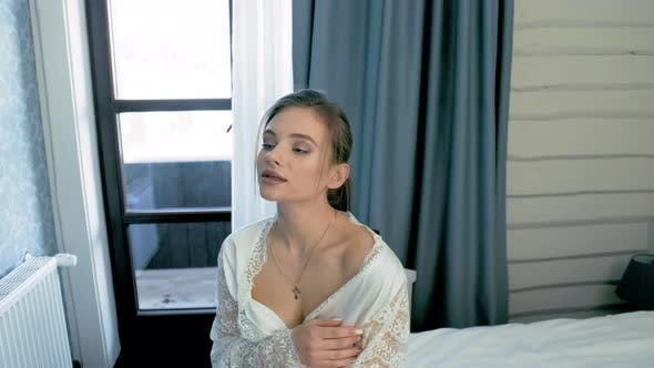 the Bride Is Sitting on the Bed in the Morning