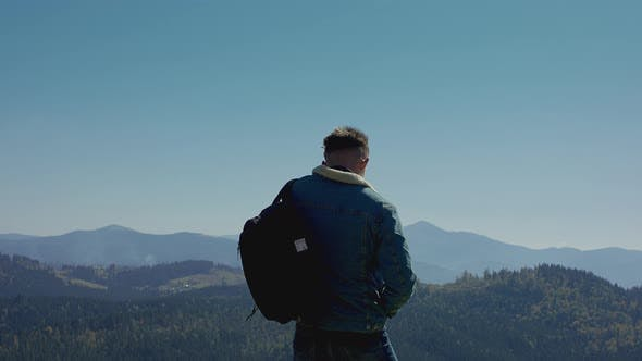 Young Man Looking At A Mountain Range.
