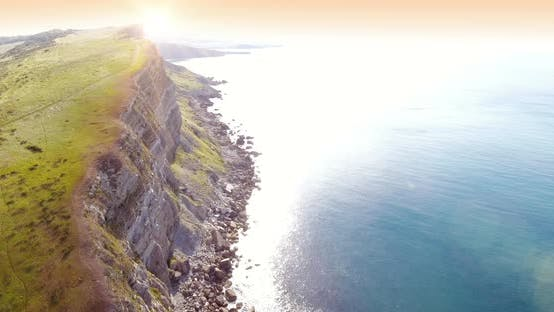 Thumbnail for Sunrise Over a Large Coastline Cliff