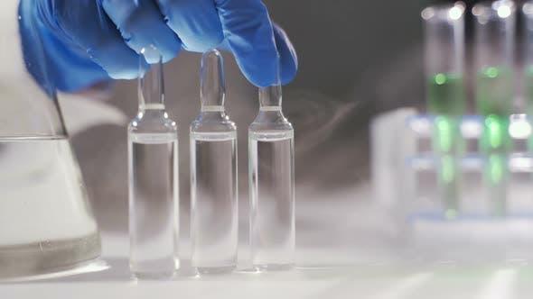 Scientist Are Putting Testtubes in Liquid Nitrogen in a Laboratory