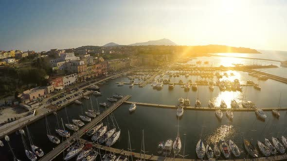 Thumbnail for Sunrise Beams Penetrating Italian Town With Nice Architecture and Luxury Marina