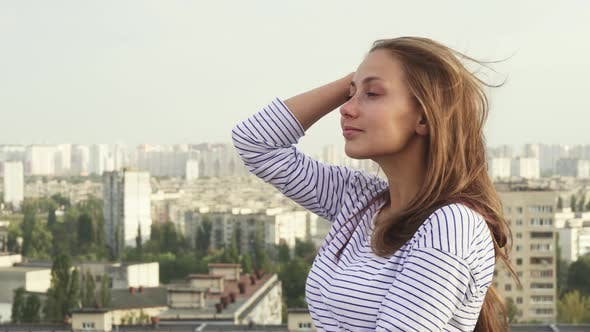 Thumbnail for A Beautiful Girl Enjoys Seeing From the Roof To the City