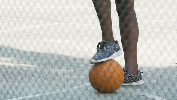 Thumbnail for African American Guy in Sneakers Waiting for Team Gathering to Play Basketball