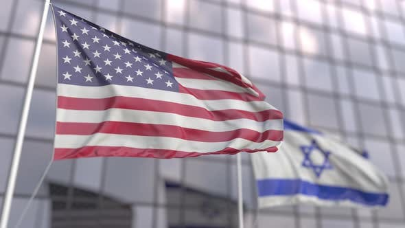 Flags of the USA and Israel in Front of a Skyscraper Facade