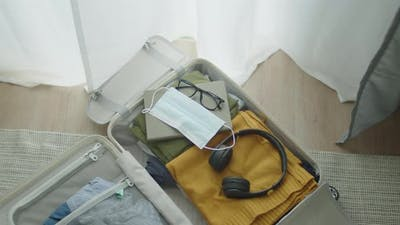 Top view shot suitcase getting ready for travel.