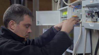 Electrician repairing fuses