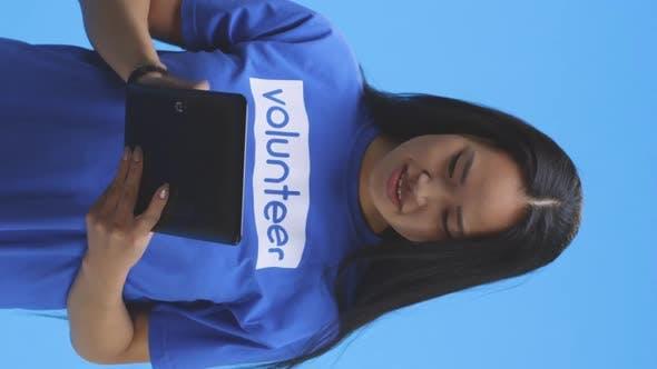 Thumbnail for Female Volunteer Using Tablet