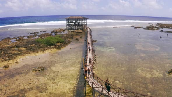 Thumbnail for Tourist People Walking Along the Bridge at the Cloud 9 Surfing Tower. Siargao Island