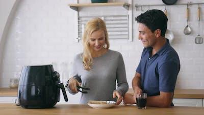 Couple Preparing Meal in Air Fryer