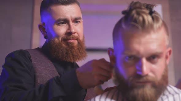 Barber Cutting Hair of Customer.