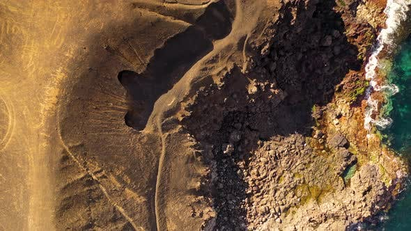 Thumbnail for Aerial view of waves breaking on a coast with rock formation, Spain.
