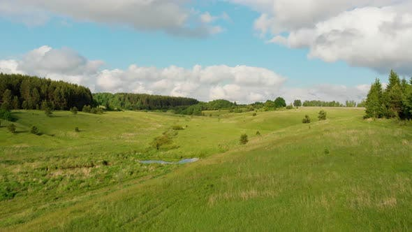 Thumbnail for Green Open Field and Blue Sky with Some Clouds