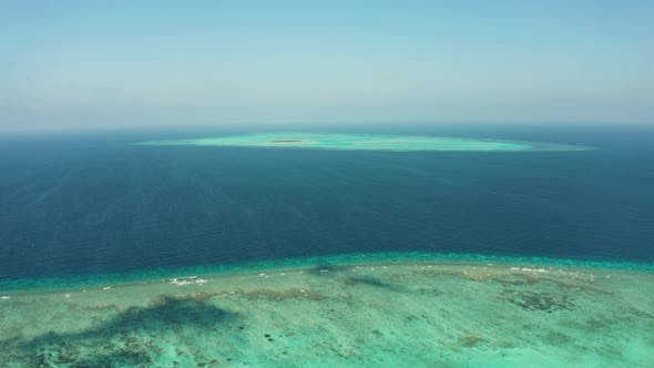 Seascape with Coral Reef and Atoll in the Blue Sea Balabac Palawan Philippines