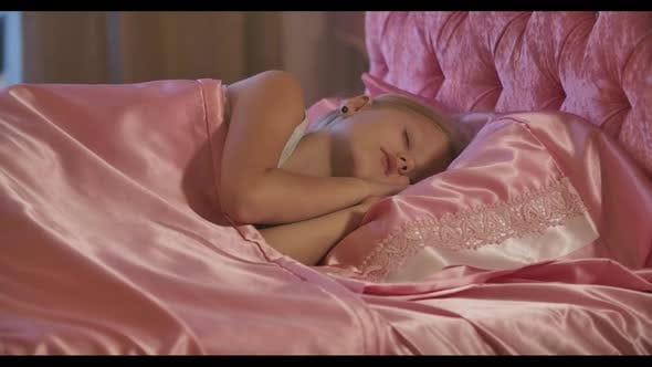 Thumbnail for Close-up of Cute Caucasian Little Girl Sleeping in Pink Bed Tired Child Resting at Home