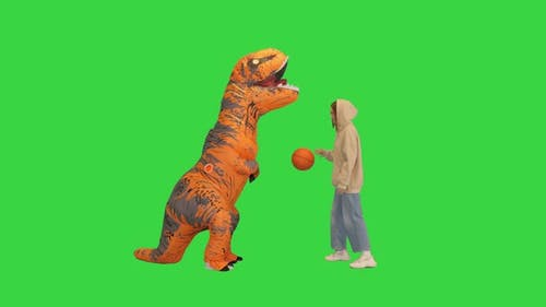 Girl Playing Basketball with a Man in Dino Costume on a Green Screen Chroma Key