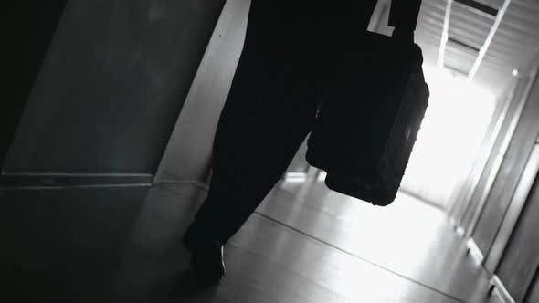Cover Image for Silhouette of Traveler Heading towards Hotel Room