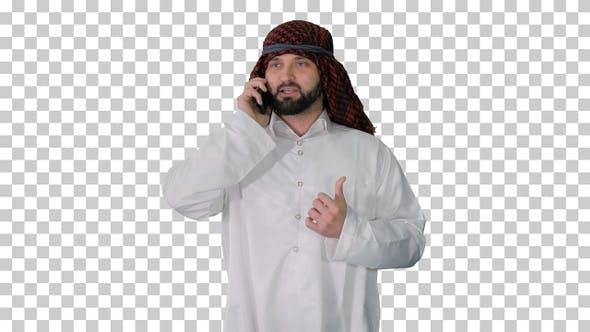 Arab sheikh making a call walking, Alpha Channel