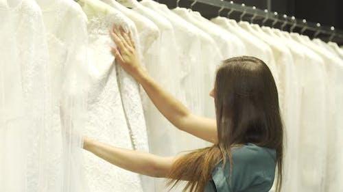 Brunette Looking at Wedding Dresses