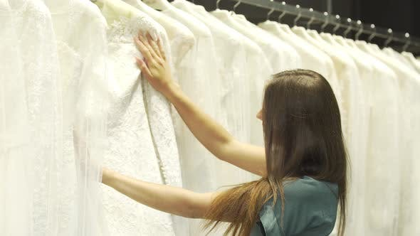 Thumbnail for Brunette Looking at Wedding Dresses