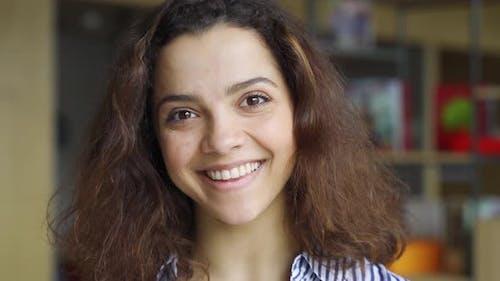 Beautiful Happy Hispanic Young Adult 20s Woman Looking at Camera Headshot