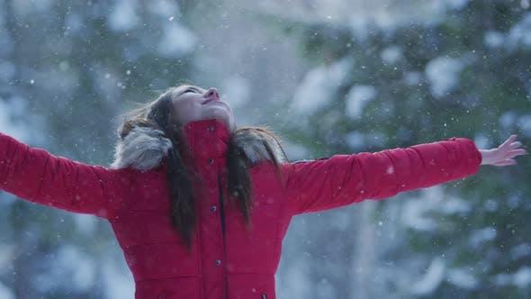 Girl enjoying a snowy day