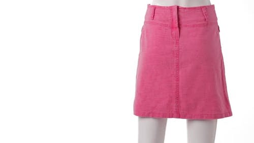 Rotating Mannequin in Pink Skirt.