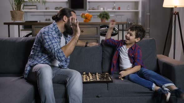 Thumbnail for Excited Son Defeated Joyful Father in Chess Game