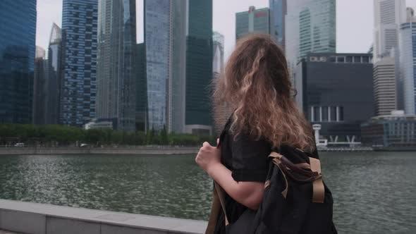 Woman Walking and Enjoying Singapore Views