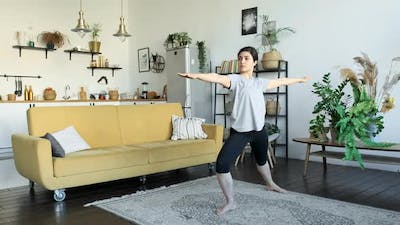 Young asian woman smile doing yoga exercises in home, exercising muscles for body health care