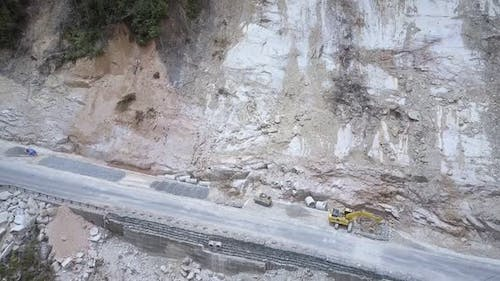 Building Equipment and Narrow Road Under High Mountain