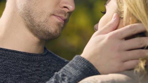 Sad Man Embracing Woman