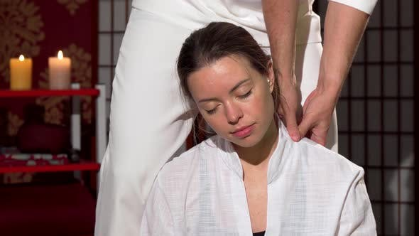 Thumbnail for Lovely Woman Smiling with Her Eyes Closed Enjoying Thai Massage at Spa